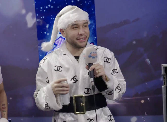 He wore a matching white Santa hat for his interview with Jimmy