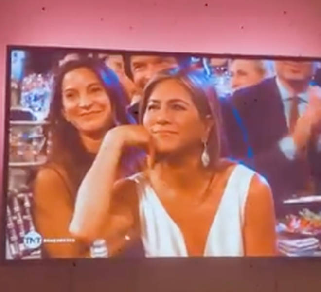 Jennifer Aniston gazes at Brad Pitt during his SAG speech