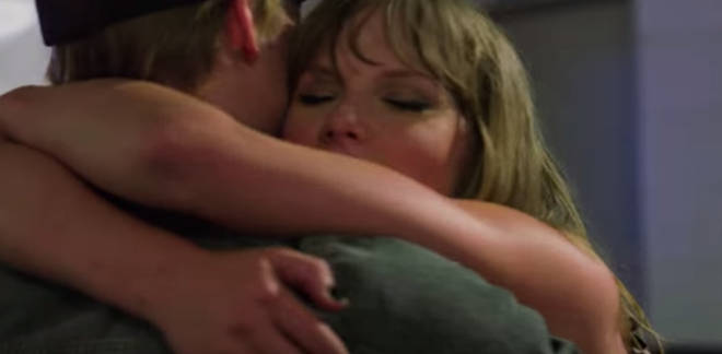 Taylor Swift throws her arms around her boyfriend in one scene of Miss Americana