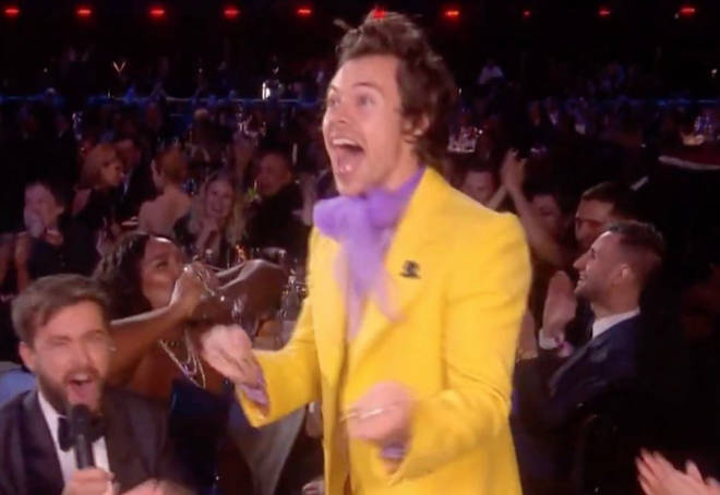 Harry Styles celebrates as Lizzo chugs a glass of tequila on the BRITs