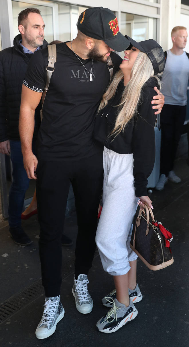 Love Island's Paige and Finn kiss at the airport