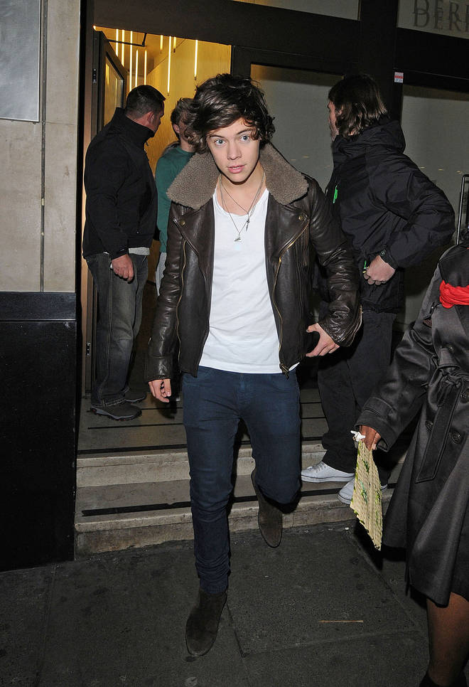 Harry Styles wearing his paper plane pendant necklace
