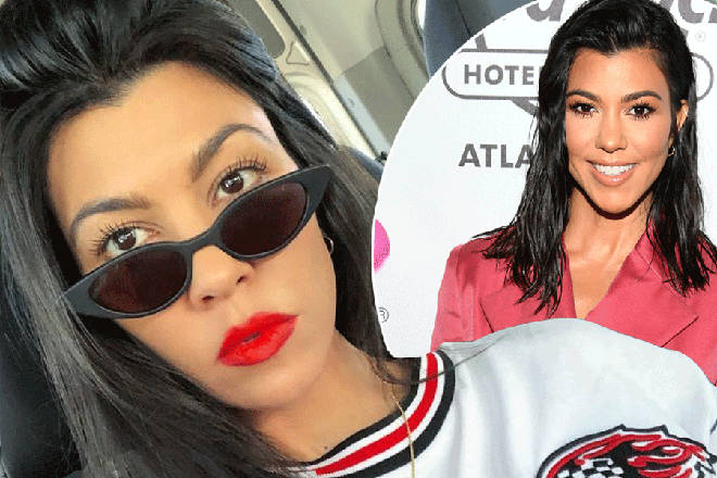 Kourtney Kardashian poses in red lipstick