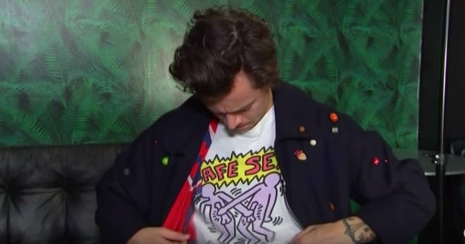 Harry Styles looked coy as he showed his t-shirt to the presenters