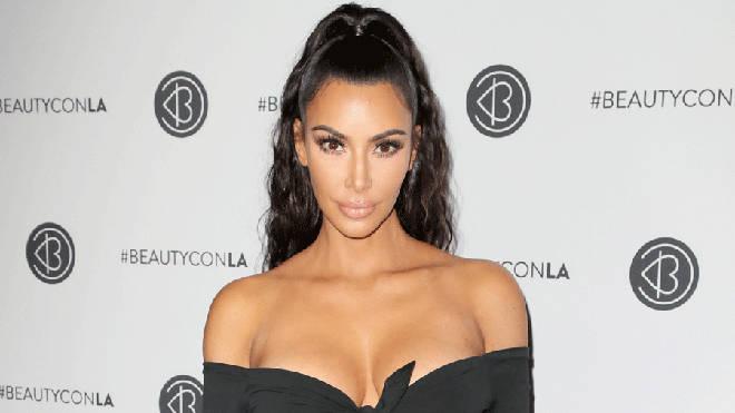 Kim Kardashian poses in black crop top