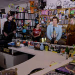 Harry Styles with his band during NPR's Tiny Desk concert