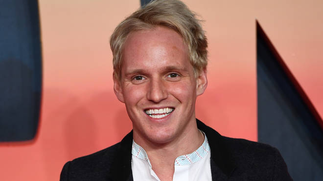 Jamie Laing poses on the red carpet in black blazer
