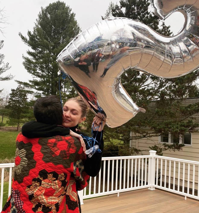 Gigi Hadid holding the balloon with blue strings has fans convinced she's pregnant with a baby boy