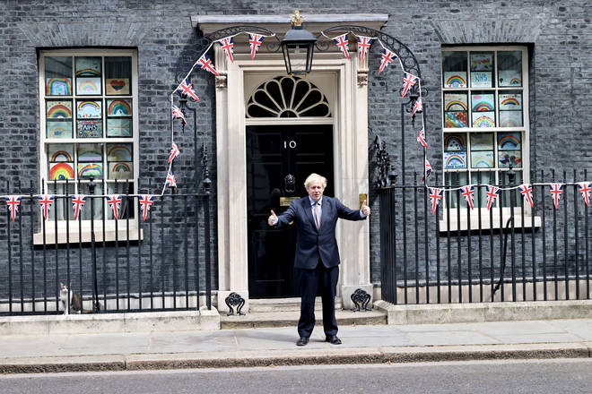 Prime Minister Boris Johnson stands outside 10 Downing Street on Friday as the UK commemorates the 75th Anniversary of Victory in Europe Day (VE Day)
