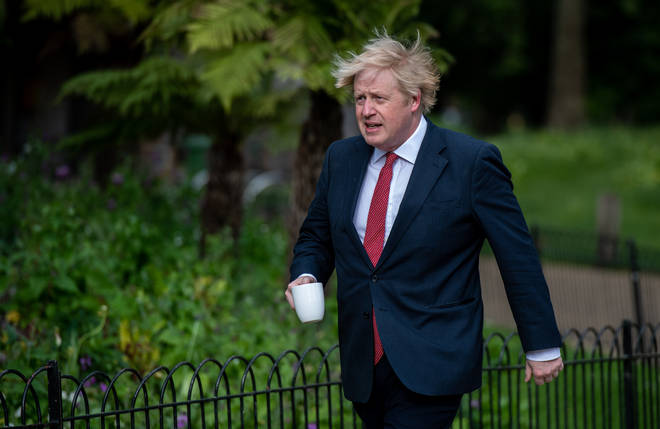 Boris Johnson demonstrating UK's eased lockdown rules
