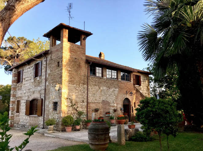 The villa is located outside of Rome in the countryside