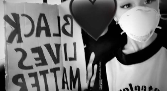 Ariana Grande marched with a 'black lives matter' placard