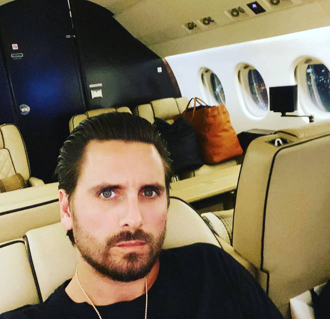 Scott Disick struggles to talk about his parents.