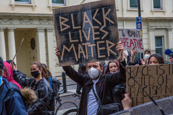 Protesters with placards at Whitehall Downing Street during...