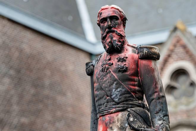 The statue of King Leopold II in Antwerp is defaced before being removed
