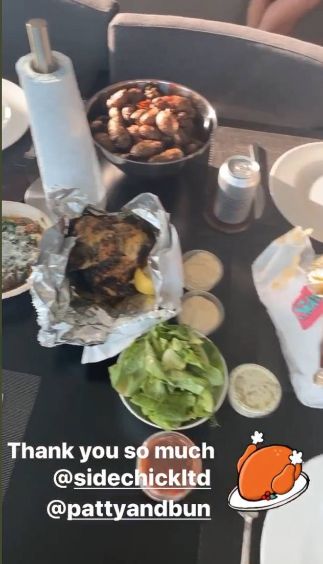 Niall Horan posted a video of his takeaway, with a pair of legs in the background