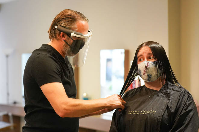Customer and worker wear masks as hair salons Reopen In England