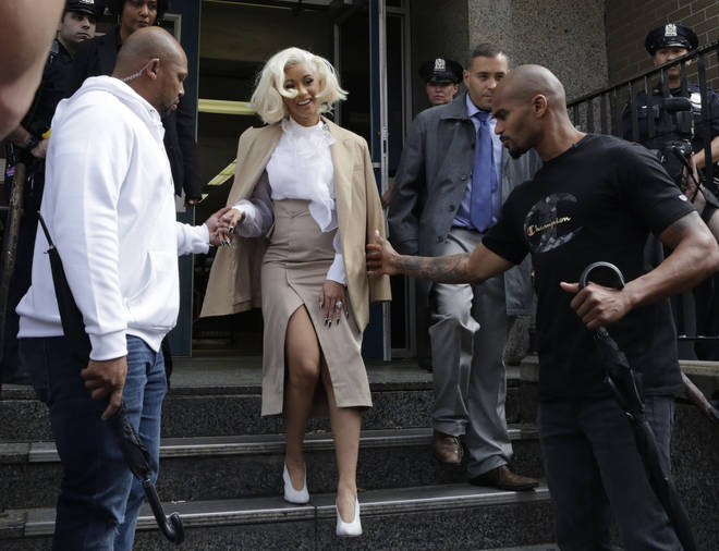 Cardi B was charged with assault after handing herslef in to police recently