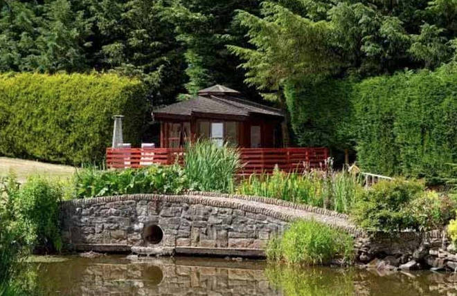 The home comes with a mini island and a summer house