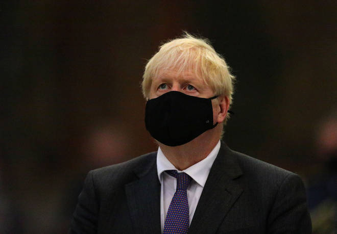 Boris Johnson wears a mask to a service at Westminster Abbey