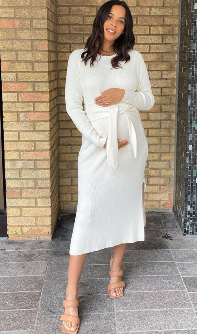 Rochelle highlighted her bump in a figure-hugging midi dress
