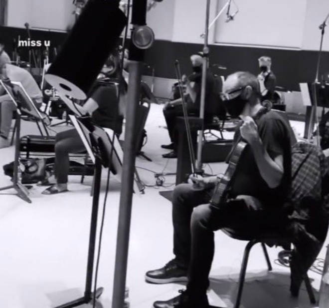 Ariana Grande posts teaser of orchestra in studio for AG6