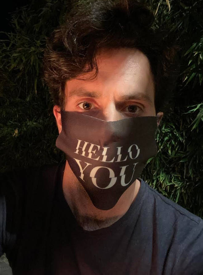Netflix shared this apt picture of Penn Badgley on set of You
