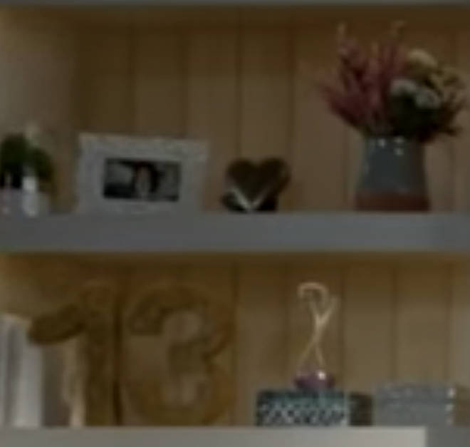 Tayolr's lucky number and an hour glass were also on the shelves