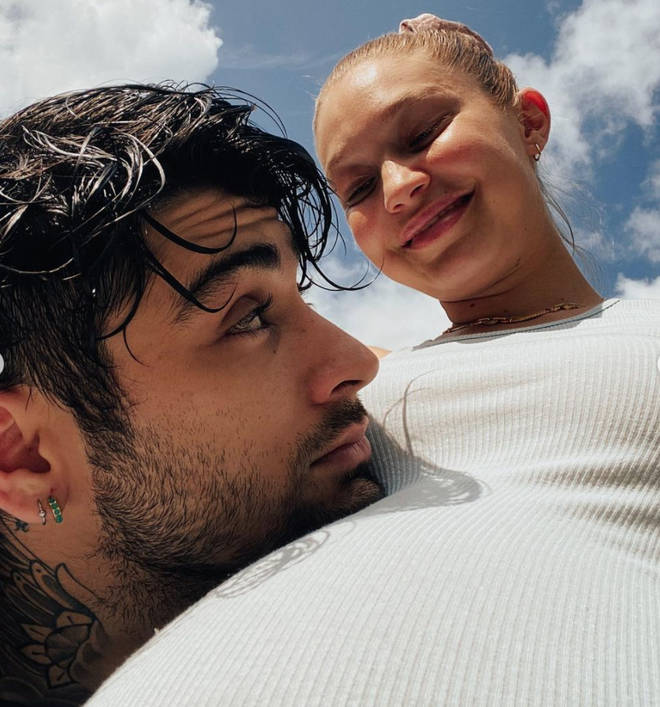 Zayn rested his head on Gigi's bump in a rare joint selfie