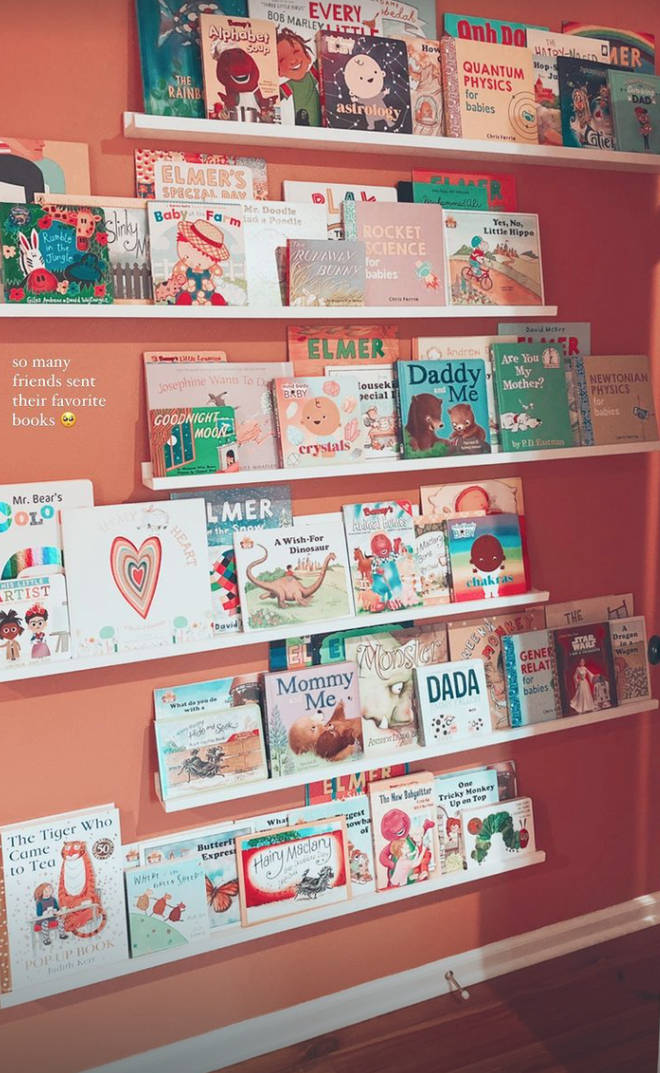 Gigi and Zayn's baby has a wall of shelves full of books