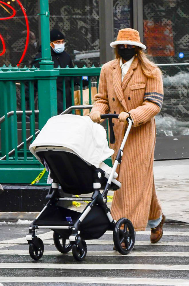 Gigi Hadid took her baby girl out for a walk in the snow