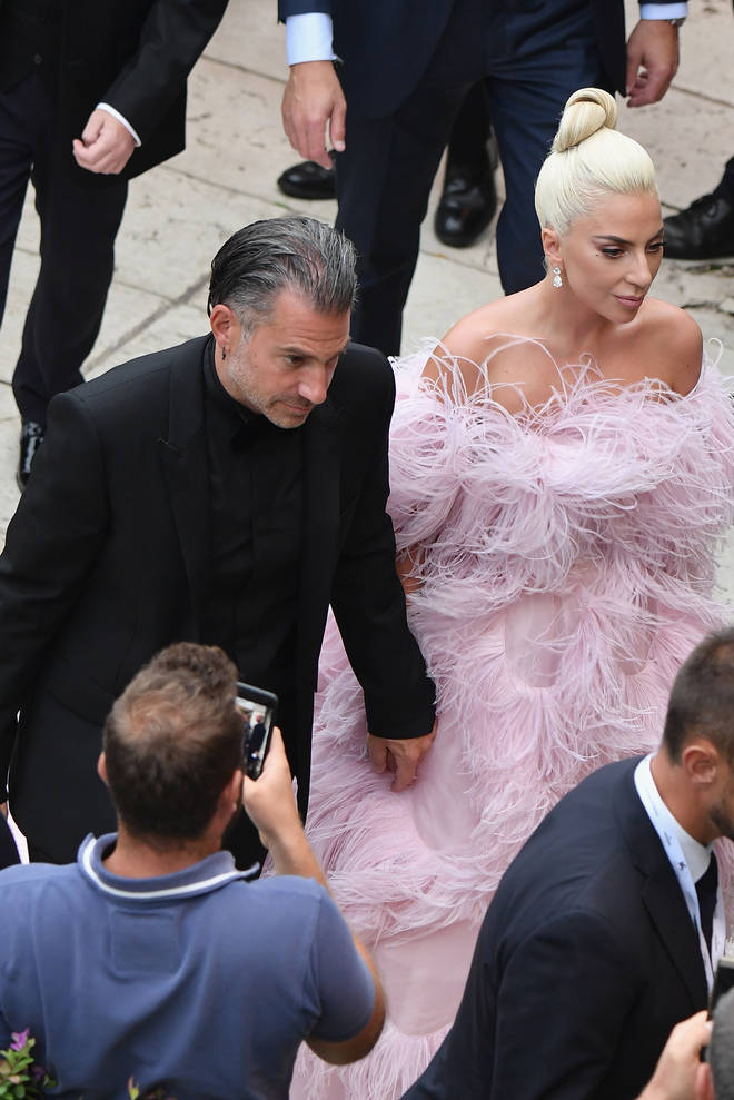 Lady Gaga holding hands with Christian Carino at Venice Film Festival