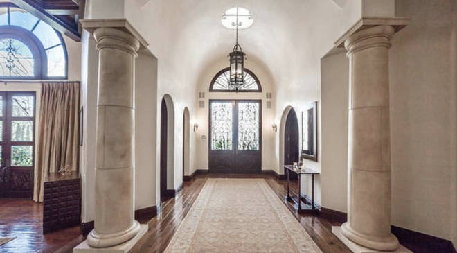 The entrance to the house has grand marble pillars