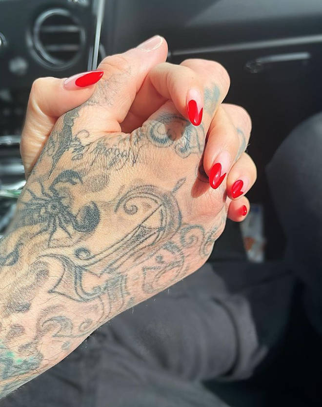 Kourtney Kardashian shared this cute photo of her holding hands with Travis Barker