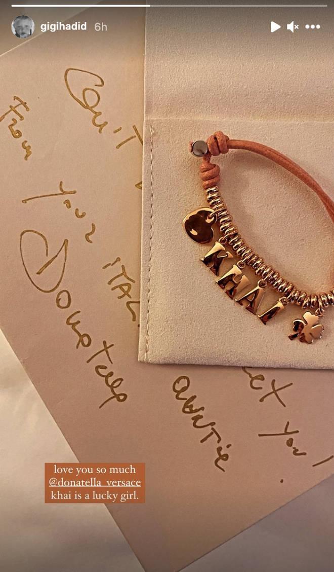 Donatella Versace gifted Khai a personalised bracelet