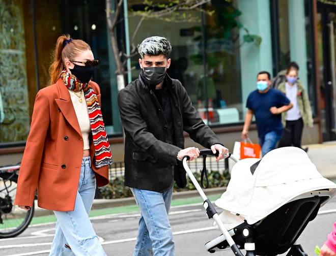 Zayn Malik and Gigi Hadid took baby Khai for a stroll in NYC.