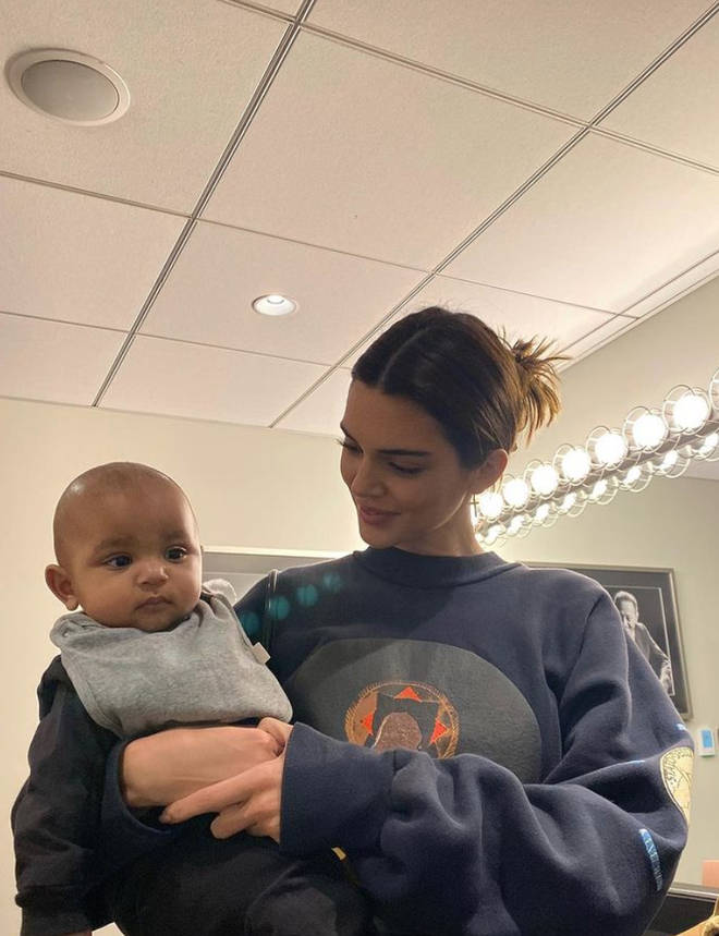 Kendall Jenner with her nephew and Kim Kardashian's son, Psalm.