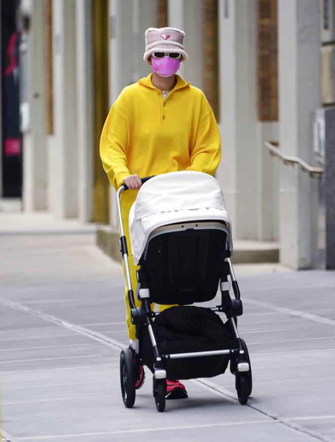 Gigi Hadid on a stroll through NYC with baby Khai.