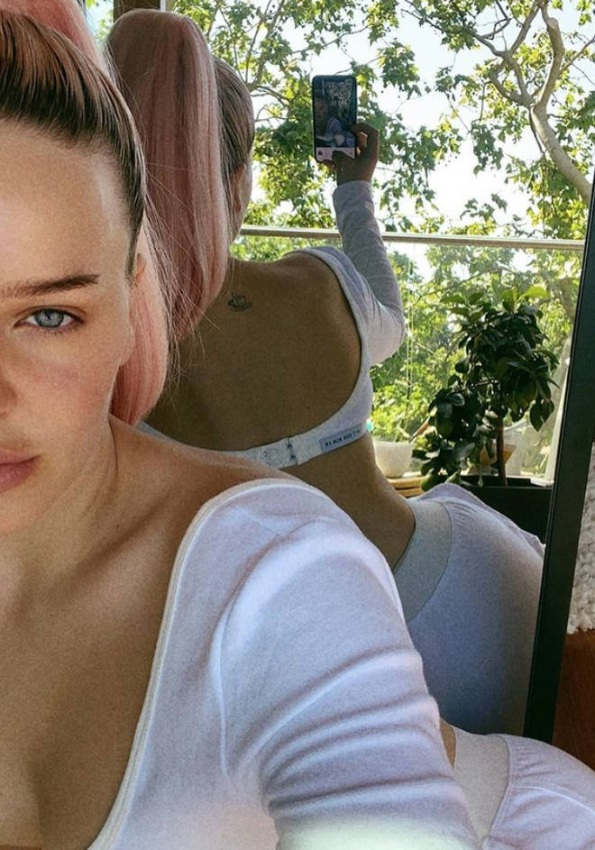 Anne-Marie has a cup of tea tattoo on her back.