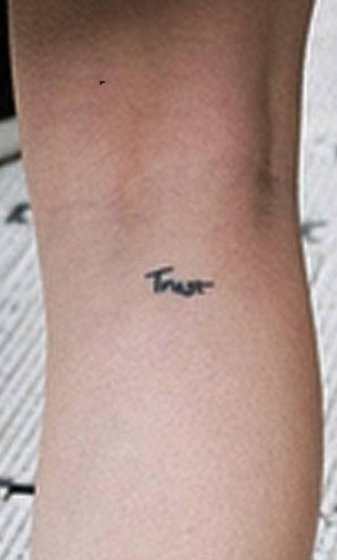 Anne-Marie has 'trust' tatted on her.