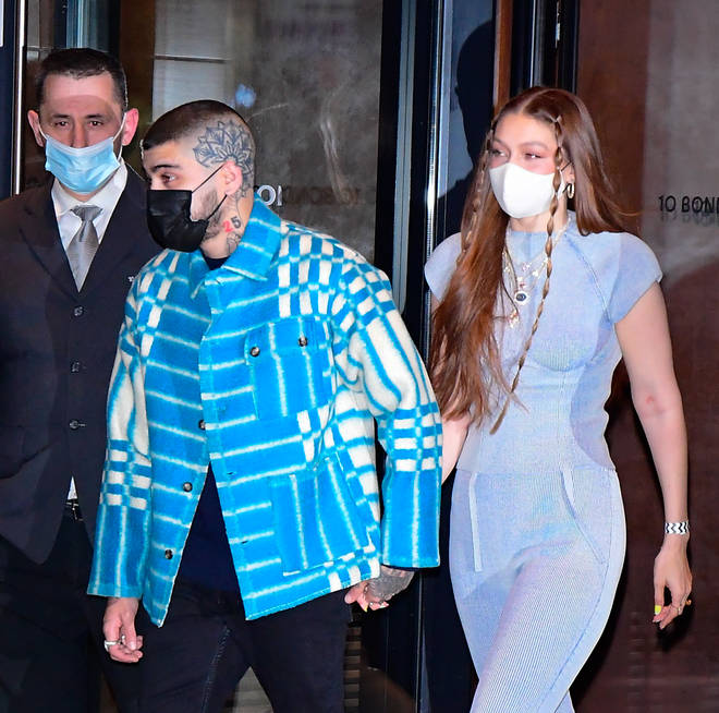 Gigi Hadid and Zayn Malik held hands as they left their home.