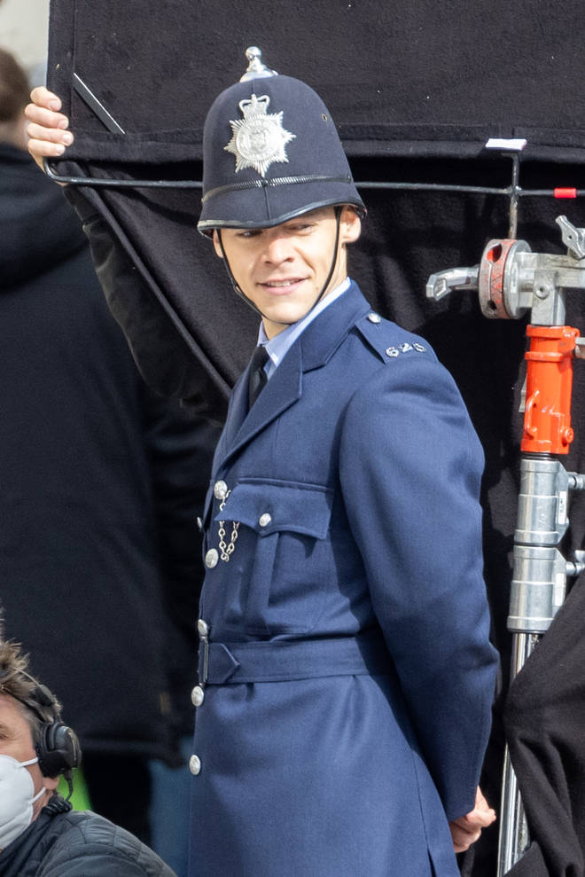 Harry Styles dressed as a policeman as he films in Brighton
