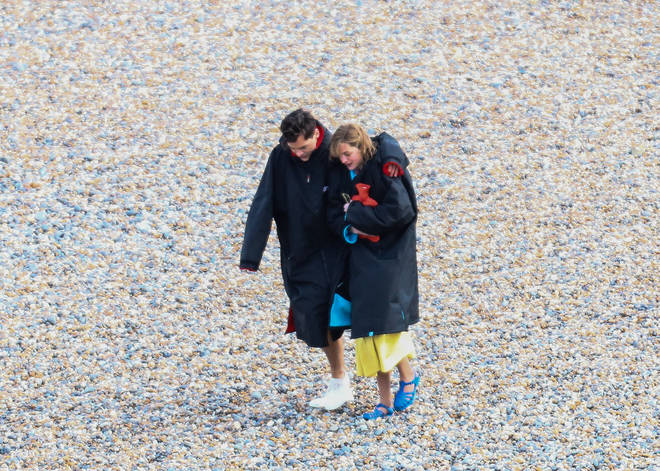 Harry Styles and his co-star Emma Corrin at Brighton as they film together.