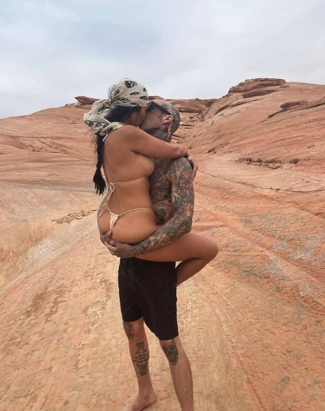 Kourtney Kardashian and Travis Barker are seriously loved up