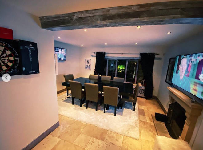 James Arthur's dining room is complete with a dart board and huge TV