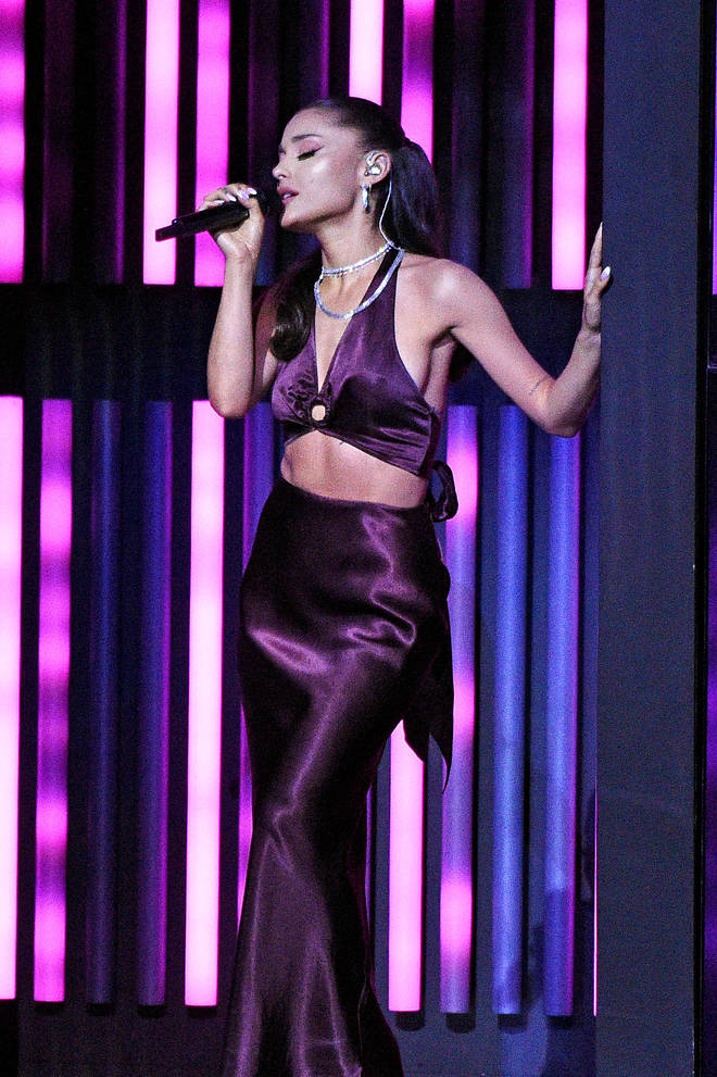 Ariana Grande's arm tattoos stayed hidden for her performance with The Weeknd