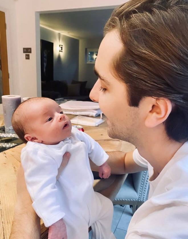 Sammy Kimmence with baby boy Santiago