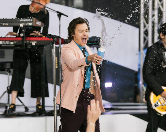 The Harry Styles fan replicated the singer's water splash during the event