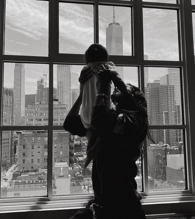Bella Hadid holding up her niece Khai