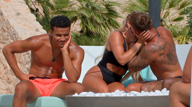 Jake Cornish has locked lips with an Islander that isn't his girlfriend...